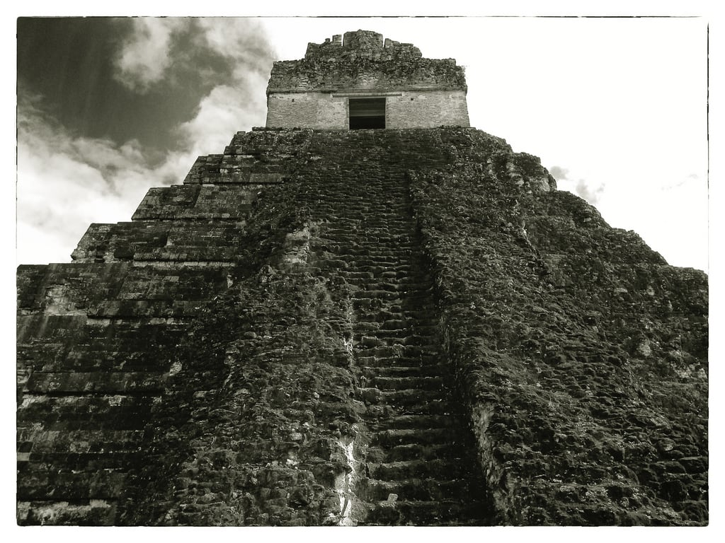 Image of Temple I near Tikal. stone sepia temple ancient pyramid maya guatemala mayan tikal rugged