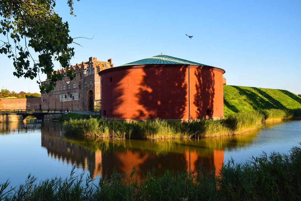Image of Malmöhus slott. autumn sky castle water reflections europe sweden outdoor malmö renaissance höst slott malmöhus