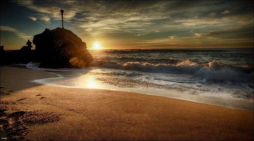 Image of Platja de la Morera. sol mar agua playa arena amanecer cielo nubes olas fotógrafo roca reflejos brillos