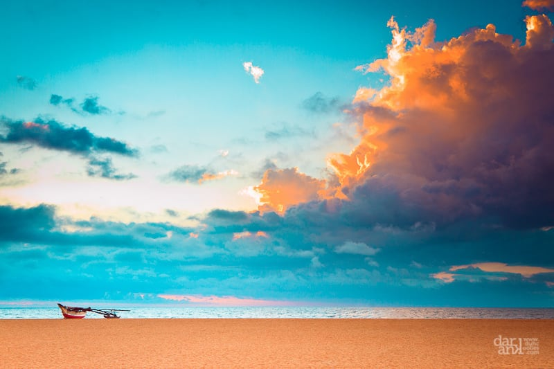 Image of Negombo Beach Park. ocean blue light sunset sea sky brown beach water clouds canon boat sand horizon 7d srilanka 24105mm negambo