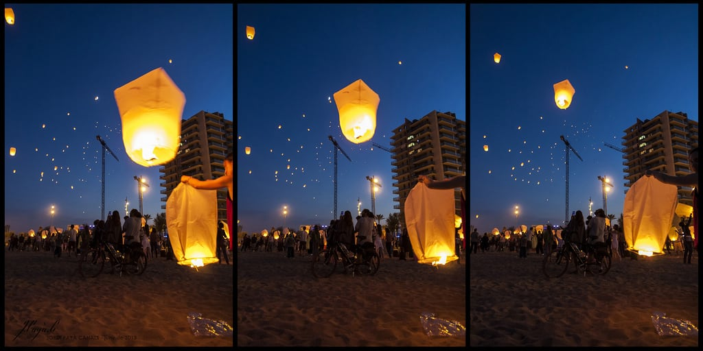 Imagine de Platja del Coco. barcelona light sunset party summer sky people beach festival night canon fire eos flying is twilight sand crowd catalonia canals lantern usm jordi efs badalona 450d 1585mm payà